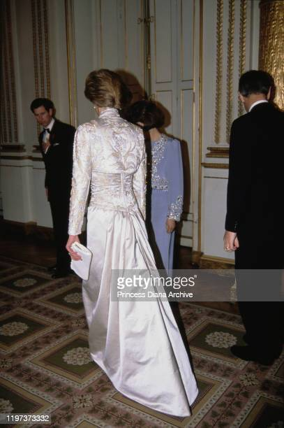 Charles and Diana Princess of Wales during a dinner at the Élysée Palace in Paris France November 1988 Diana is wearing a white gown by Victor...