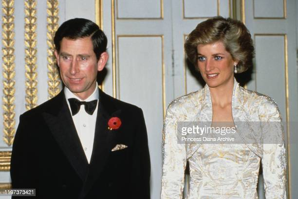 Charles and Diana, Princess of Wales during a dinner at the Élysée Palace in Paris, France, November 1988. Diana is wearing a white gown by Victor...