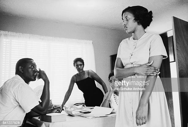 Charles and Myrlie Evers and two other women discuss issues in an office