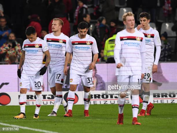 Charles Aranguiz Joel Pohjanpalo Kevin Volland Julia Brandt and Kai Havertz of Bayer 04 Leverkusen leaving pitch after the Bundesliga match between...