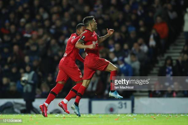 Charles Aranguiz of Bayer 04 Leverkusen celebrates after scoring his team's second goal during the UEFA Europa League round of 16 first leg match...