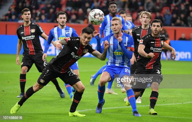 Charles Aranguiz of Bayer 04 Leverkusen Fabian Lustenberger of Hertha BSC and Kevin Volland of Bayer 04 Leverkusen during the Bundesliga match...
