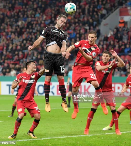 Charles Aranguiz of Bayer 04 Leverkusen Marc Torrejon of 1 FC Union Berlin Dominik Kohr and Lucas Alario of Bayer 04 Leverkusen during the game...