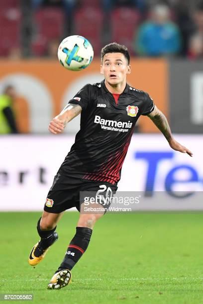 Charles Aranguiz of Bayer 04 Leverkusen plays the ball during the Bundesliga match between FC Augsburg and Bayer 04 Leverkusen at WWKArena on...