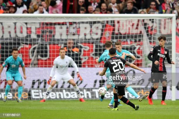 Charles Aranguiz of Bayer 04 Leverkusen scores his team's first goal during the Bundesliga match between Bayer 04 Leverkusen and SportClub Freiburg...