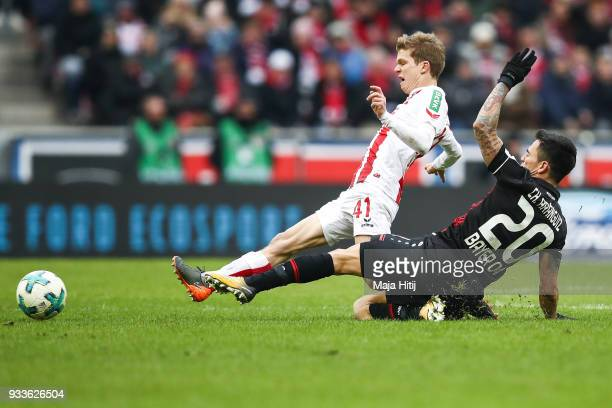 Charles Aranguiz of Bayer Leverkusen and Vincent Koziello of 1FC Koeln battle for the ball during the Bundesliga match between 1 FC Koeln and Bayer...