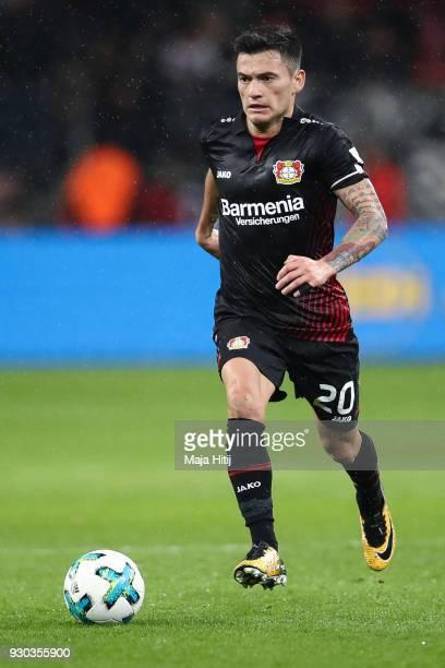 Charles Aranguiz of Bayer Leverkusen controls the ball during the Bundesliga match between Bayer 04 Leverkusen and Borussia Moenchengladbach at...