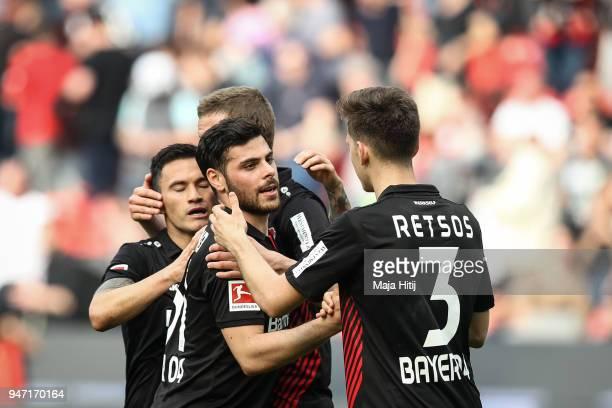 Charles Aranguiz of Bayer Leverkusen Kevin Volland and Panagiotis Retsos of Bayer Leverkusen celebrate after the Bundesliga match between Bayer 04...