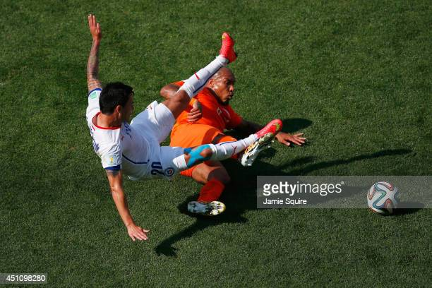 Charles Aranguiz of Chile and Nigel de Jong of the Netherlands collide during the 2014 FIFA World Cup Brazil Group B match between the Netherlands...