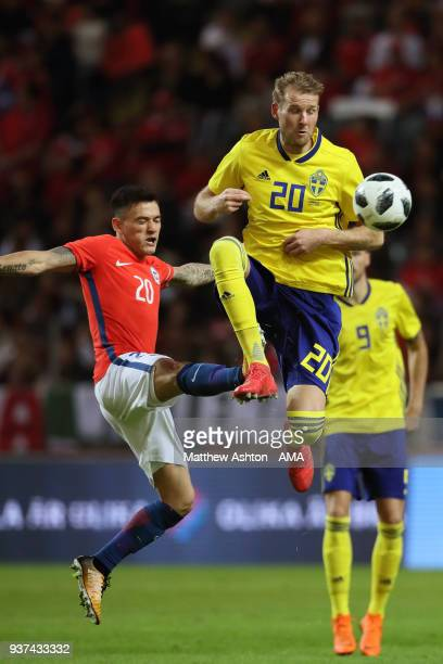 Charles Aranguiz of Chile and Ola Toivonen of Sweden during the International Friendly match between Sweden and Chile at Friends arena on March 24...