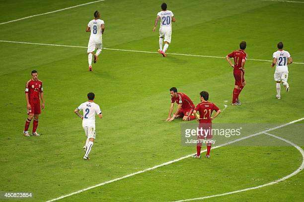 Charles Aranguiz of Chile celebrates scoring his team's second goal as dejected Spain players look on during the 2014 FIFA World Cup Brazil Group B...