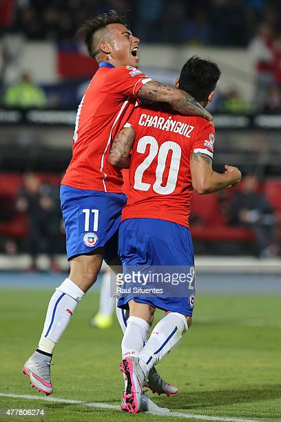 Charles Aranguiz of Chile celebrates with teammate Eduardo Vargas after scoring the third goal of his team during the 2015 Copa America Chile Group A...