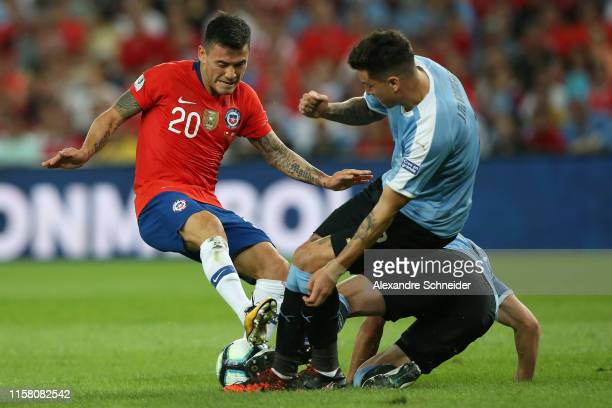Charles Aranguiz of Chile competes for the ball with Jose Gimenez of Uruguay during the Copa America Brazil 2019 group C match between Chile and...