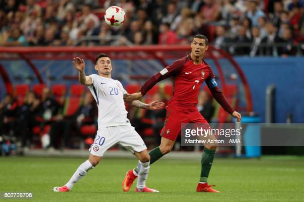 Charles Aranguiz of Chile competes with Cristiano Ronaldo of Portugal during the FIFA Confederations Cup Russia 2017 SemiFinal match between Portugal...