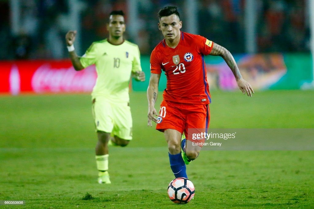 Charles Aranguiz of Chile drives the ball during a match between Chile and Venezuela as part of FIFA 2018 World Cup Qualifiers at Monumental Stadium on March 28, 2017 in Santiago, Chile.