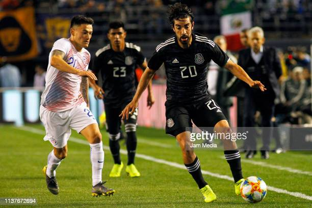 Charles Aranguiz of Chile fights for the ball with Rodolfo Pizarro of Mexico during an international friendly match between Chile and Mexico at...