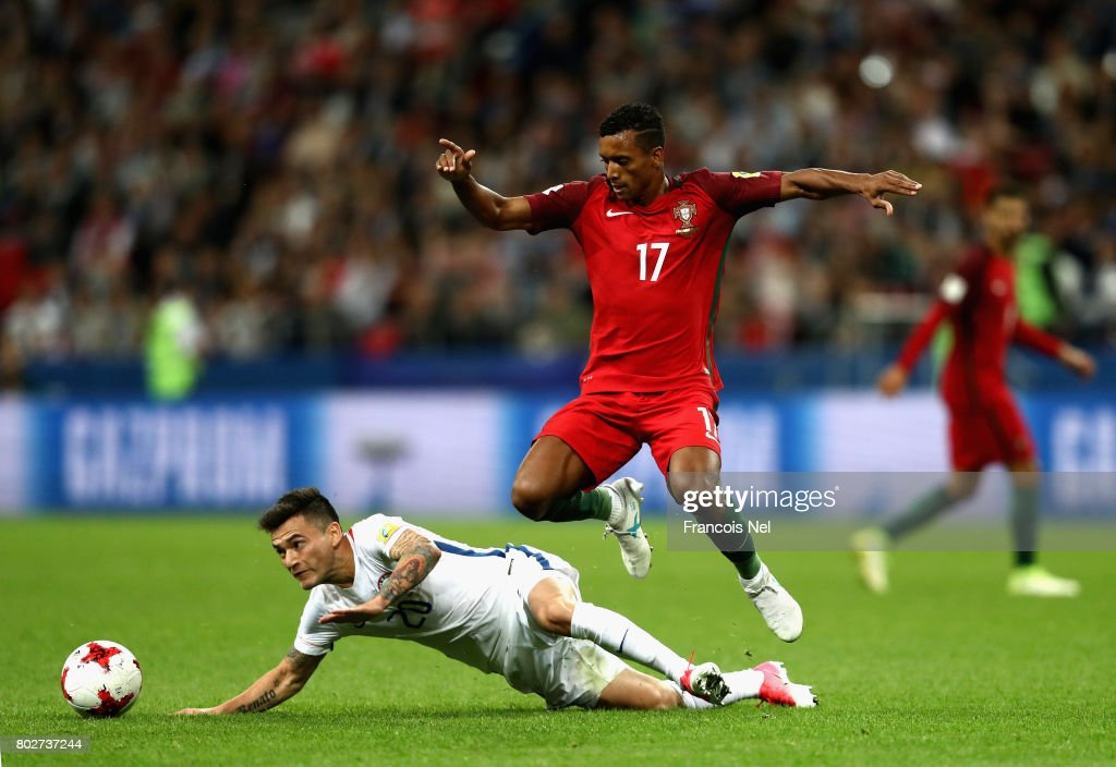 Charles Aranguiz of Chile is fouled by Nani of Portugal during the FIFA Confederations Cup Russia 2017 Semi-Final between Portugal and Chile at Kazan Arena on June 28, 2017 in Kazan, Russia.