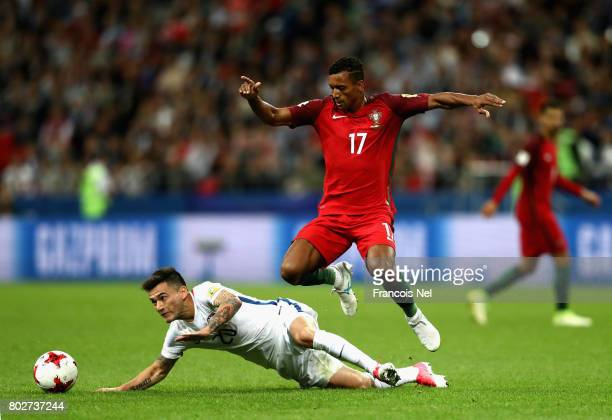 Charles Aranguiz of Chile is fouled by Nani of Portugal during the FIFA Confederations Cup Russia 2017 SemiFinal between Portugal and Chile at Kazan...