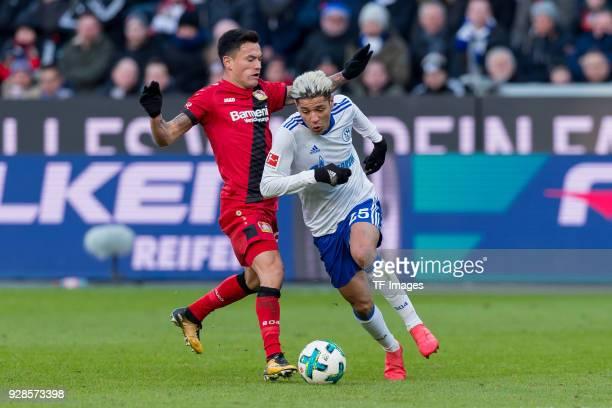 Charles Aranguiz of Leverkusen and Amine Harit of Schalke battle for the ball during the Bundesliga match between Bayer 04 Leverkusen and FC Schalke...