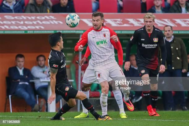 Charles Aranguiz of Leverkusen and Daniel Baier of Augsburg during the Bundesliga match between FC Augsburg and Bayer 04 Leverkusen at WWKArena on...