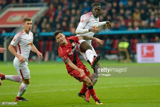 Charles Aranguiz of Leverkusen and Ibrahima Konate battle for the ball during the Bundesliga match between Bayer 04 Leverkusen and RB Leipzig at...