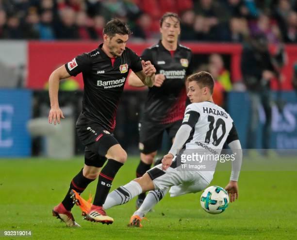 Charles Aranguiz of Leverkusen and Thorgan Hazard of Moenchengladbach battle for the ball during the Bundesliga match between Bayer 04 Leverkusen and...