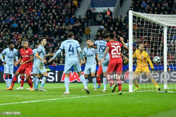 Charles Aranguiz of Leverkusen forces the own goal by Thomas of Atletico Madrid during the UEFA Champions League group D match between Bayer...