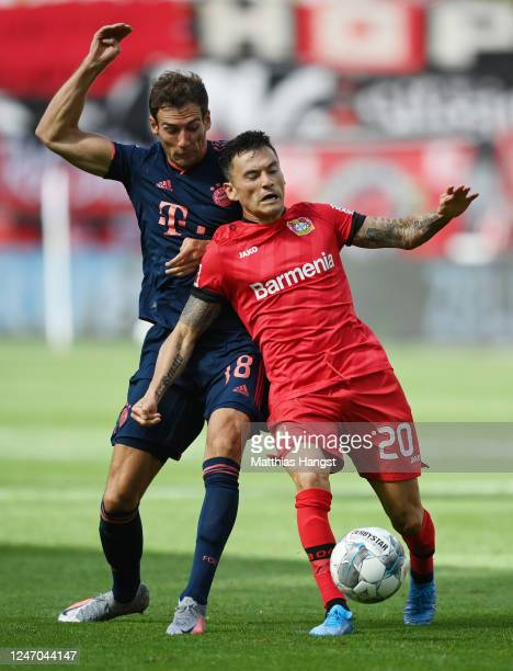 Charles Aranguiz of Leverkusen is challenged by Leon Goretzka of Muenchen during the Bundesliga match between Bayer 04 Leverkusen and FC Bayern...