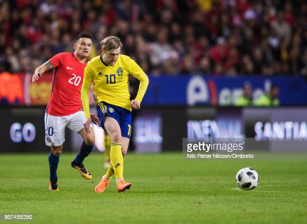 Charles Aranquiz of Chile and Emil Forsberg of Sweden during the International Friendly match between Sweden and Chile at Friends arena on March 24...