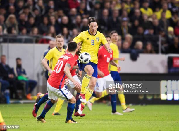 Charles Aranquiz of Chile and Gustav Svensson of Sweden competes for the ball during the International Friendly match between Sweden and Chile at...