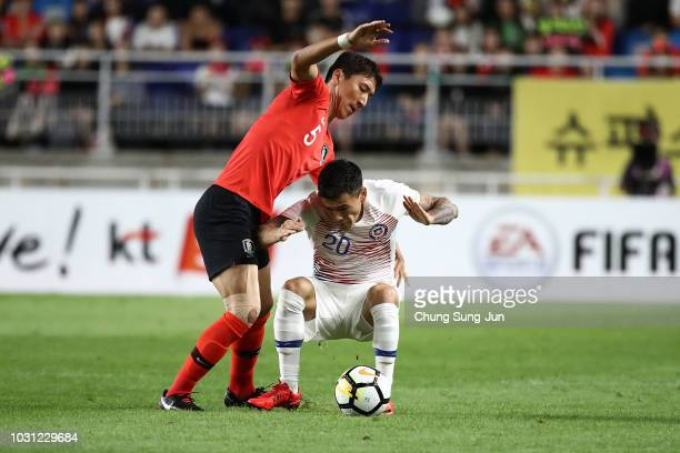 Charles Aránguiz of Chile competes for the ball with Jung WooYoung of South Korea during the International friendly match between South Korea and...