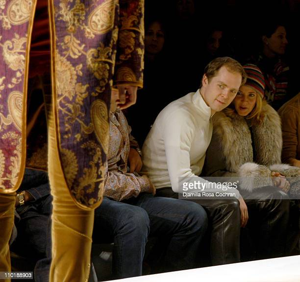 Charles Askegard and Candace Bushnell during Olympus Fashion Week Fall 2004 Nicole Miller Front Row at Studio Noir at Bryant Park in New York City...