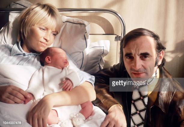 Charles Aznavour and his wife Ulla pose with their daughter Katia in a maternity in Paris on October 13 1969 AFP PHOTO