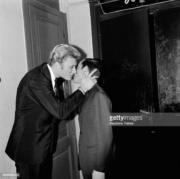 Charles Aznavour In His Dressing Room Of Paris Olympia Music Hall Receives The Congratulations Of Singer Johnny Hallyday For His Song Recital in...