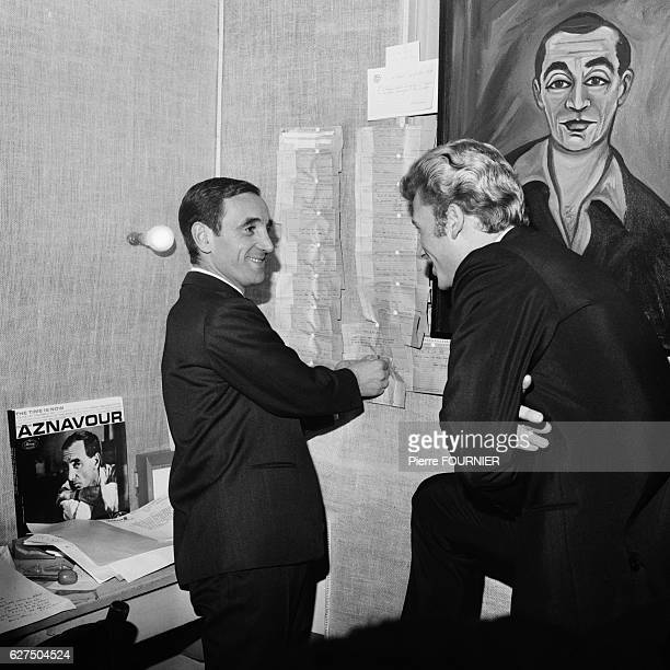 Charles Aznavour in his dressing room with Johnny Hallyday at the Olympia music hall