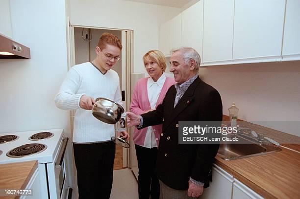 Charles Aznavour In New York City And Montreal En avril 1999 au Canada dans la cuisine de leur fils Nicolai étudiant en biologie à Montréal le...
