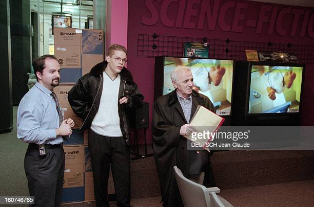 Charles Aznavour In New York City And Montreal En avril 1999 au Canada le chanteur compositeur et acteur Charles AZNAVOUR et son fils Nicolai...