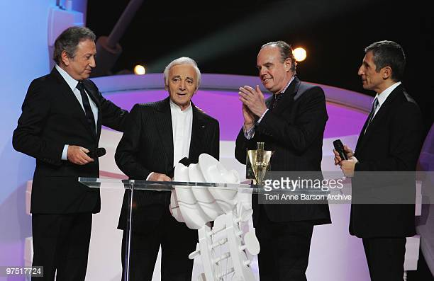Charles Aznavour receives award from Michel Drucker French Minister of Culture Frederic Mitterand and Naguiperforms during the 25th Victoires de la...