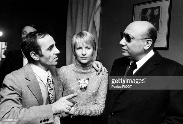 Charles Aznavour with his wife Ulla and Bruno Coquatrix
