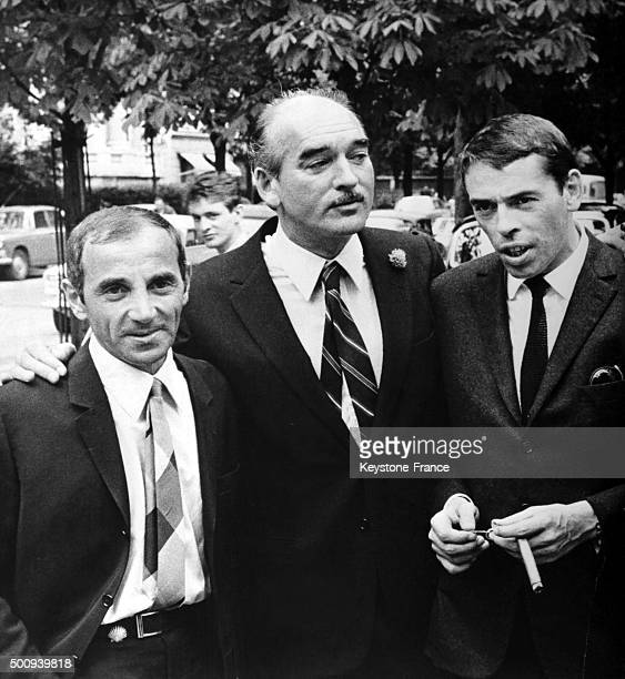 Charles Aznavour with producer Eddie Barclay and Jacques Brel in Paris France circa 1960