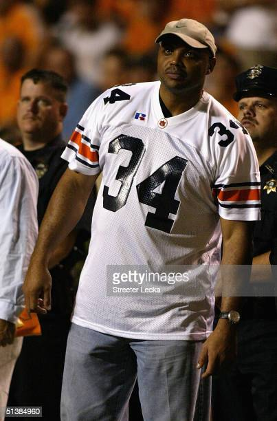 Charles Barkley, an Auburn alumni, watches the Auburn Tigers play the Tennessee Volunteers on the sidelines at Neyland Stadium on October 2, 2004 in...