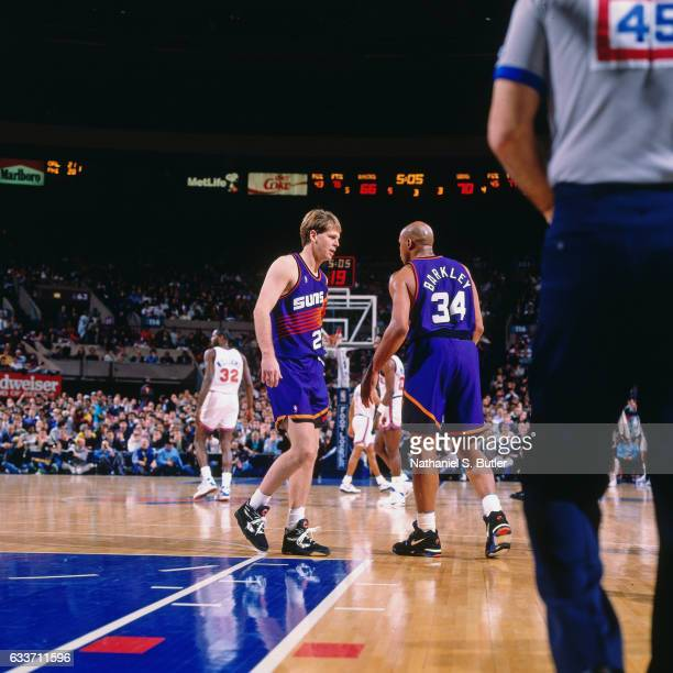 Charles Barkley and Danny Ainge of the Phoenix Suns talk during a game played circa 1993 at the Madison Square Garden in New York City NOTE TO USER...