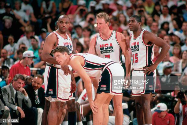 Charles Barkley Christian Laettner Larry Bird and Magic Johnson of the United States National Team discuss strategy during the1992 Summer Olympics in...