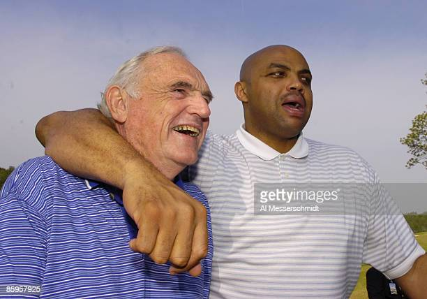 Charles Barkley clowns around with basketball coach Wimp Sanderson during the Regions Charity Classic Charter Communications ProAm at Robert Trent...