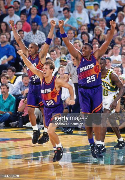 Charles Barkley Danny Ainge and Oliver Miller of the Phoenix Suns react against the Seattle SuperSonics during the game 4 of the Western Conference...