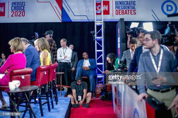 Charles Barkley former National Basketball Association player center sits on a chair in the spin room following the Democratic presidential candidate...