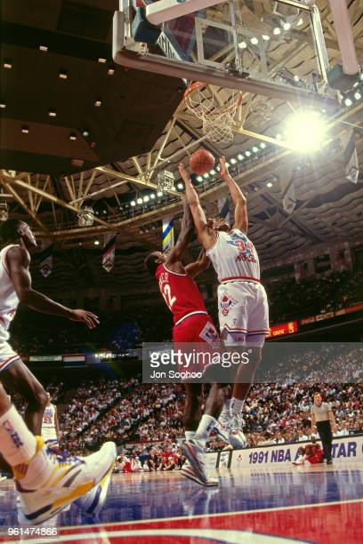Charles Barkley of East team handles the ball against the West team during the AllStar game circa 1991 at the Charlotte Coliseum in Charlotte North...