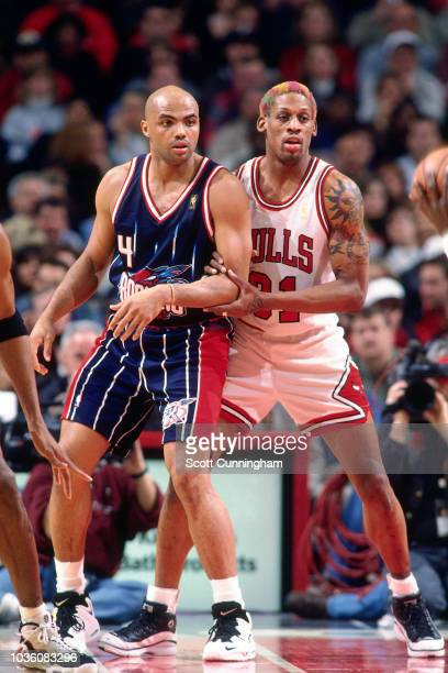 Charles Barkley of the Houston Rockets on guard during the game against Dennis Rodman of the Chicago Bulls on January 11 1997 at the United Center in...