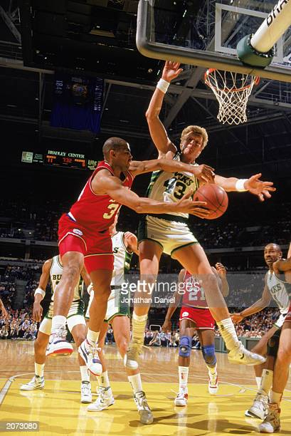 Charles Barkley of the Philadelphia 76ers attempts to pass the ball around Jack Sikma of the Milwaukee Bucks during the 19881989 NBA season game at...