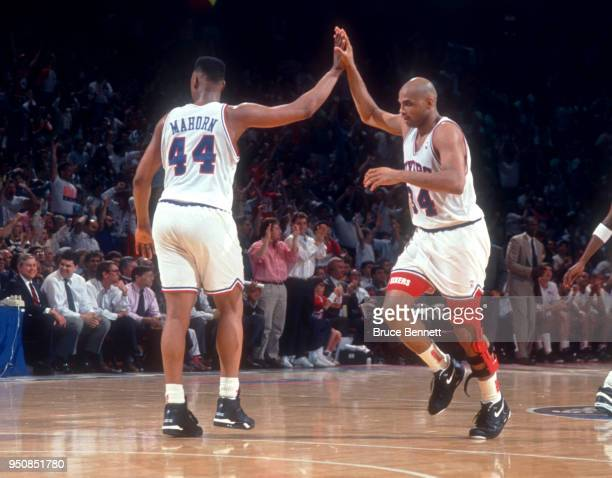 Charles Barkley of the Philadelphia 76ers gets a high-five from teammate Rick Mahorn during an NBA game against the Milwaukee Bucks on April 30, 1991...